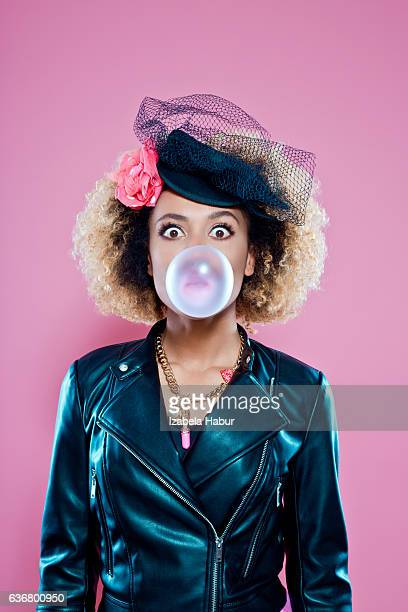 young woman blowing bubble gum - skirt blowing stock photos and pictures