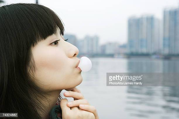 Young woman blowing bubble