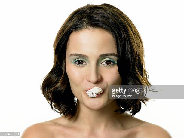 Young woman blowing bubble with gum