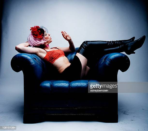 Young Woman Blowing on Her Nails Sitting Armchair
