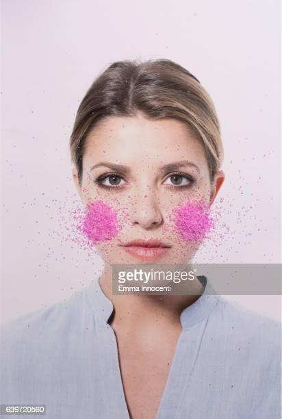 Young woman blushing