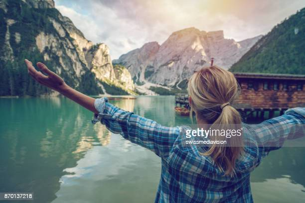young woman body positive, arms outstretched - pragser wildsee stock pictures, royalty-free photos & images
