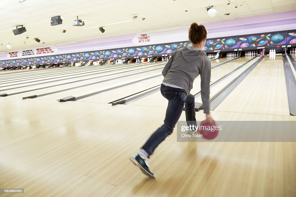 Young woman bowling : Stock Photo