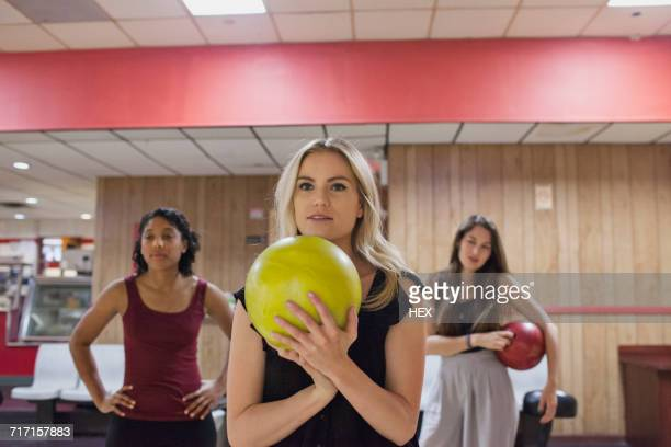 a young woman bowling.  - ボーリング場 ストックフォトと画像