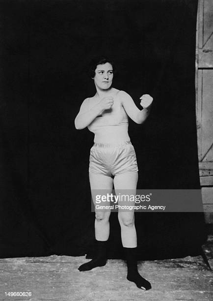A young woman boxer poses in the upright stance circa 1935