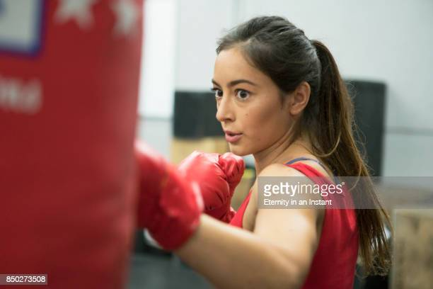 young woman boxing in a gym - ボクシング 女性 ストックフォトと画像