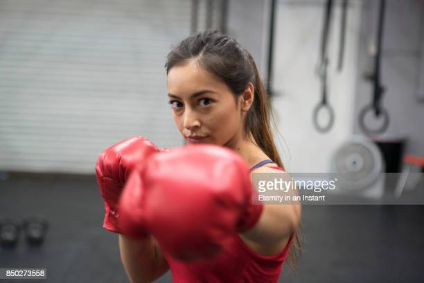 Young woman boxing in a gym