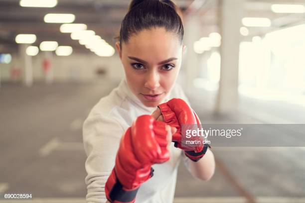 young woman boxing in the gym - combat sport stock pictures, royalty-free photos & images