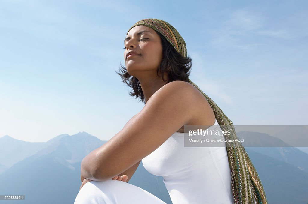 Young woman breathes the mountain air : Stock Photo