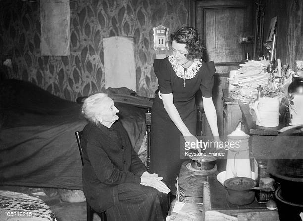 Young Woman Brings At Home Help To An Old Woman In Her Small Apartment In 1936