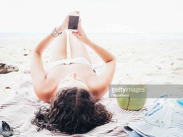 Young Woman Browsing The Net During Vacations