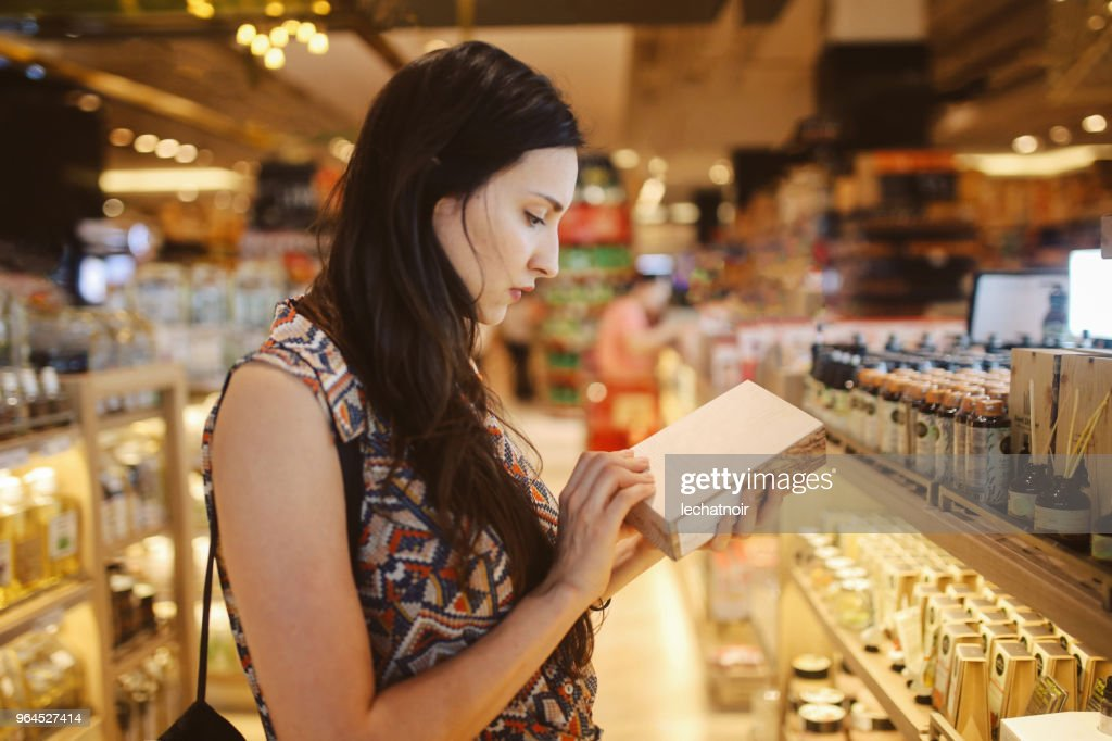 Young woman browsing through the stores in Bangkok shopping mall : Stock Photo
