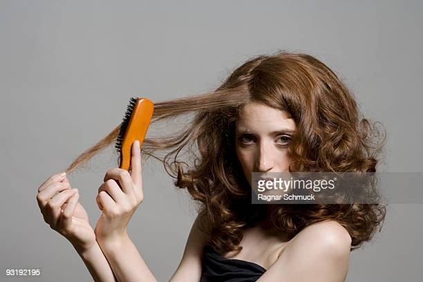 A young woman brushing her hair