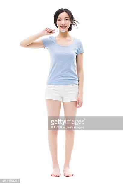 Young woman brushing teeth