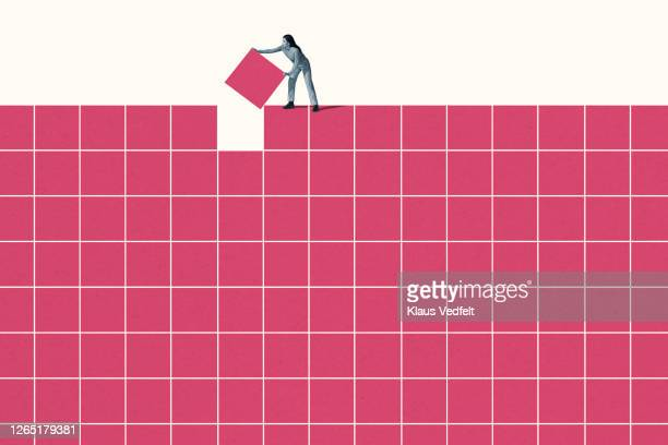 young woman building pink grid pattern - incomplete stock pictures, royalty-free photos & images