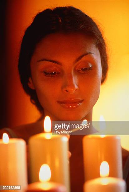 young woman burning candles - candle of hope stock pictures, royalty-free photos & images