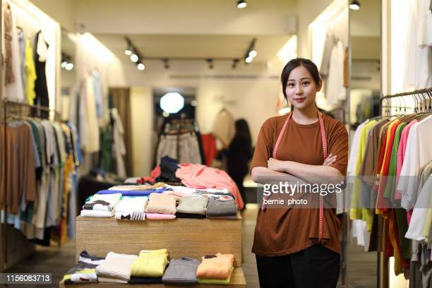 young woman business owner in a clothes shop, portrait - small stock pictures, royalty-free photos & images