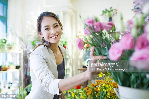 Young woman buying flowers