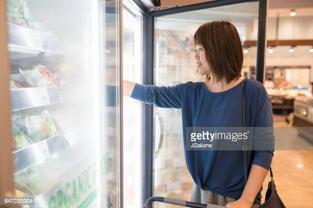 Young woman buying frozen food