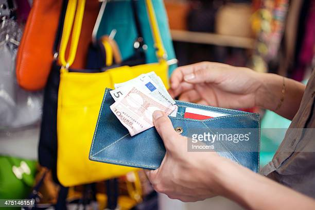 young woman buying handbag, san lorenzo market, florence, tuscany, italy - commercial activity stock photos and pictures