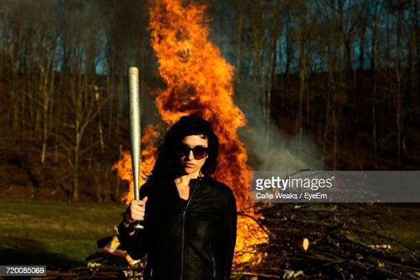 Young Woman By Bonfire In Forest
