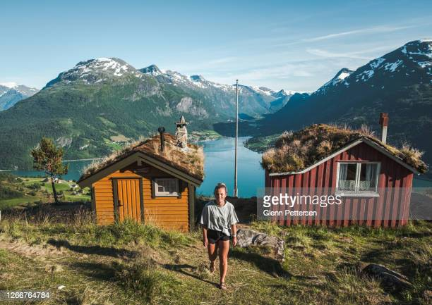 young woman by fjord in norway. - scandinavian ethnicity stock pictures, royalty-free photos & images