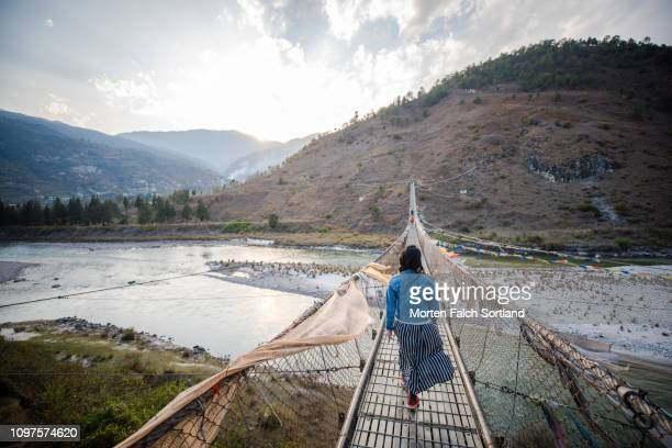 a young woman by the punakha suspension bridge in punakha, bhutan. - プナカ ストックフォトと画像