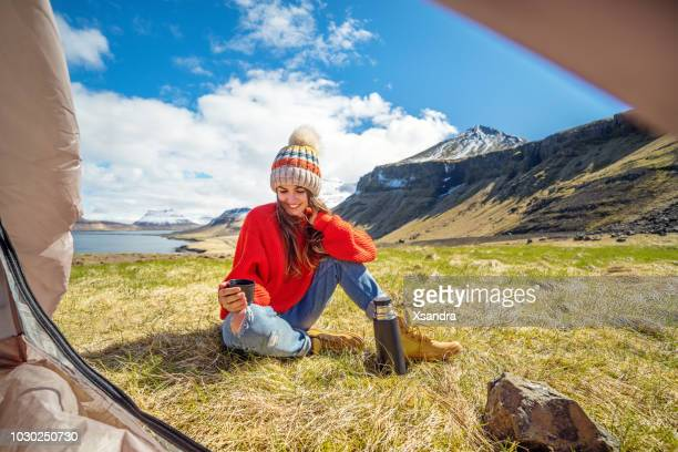 young woman camping near the ocean in iceland - wide shot stock pictures, royalty-free photos & images
