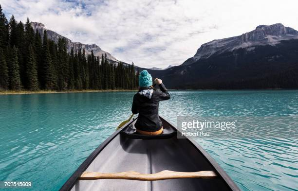 Young woman canoeing, rear view, Emerald Lake, Yoho National Park, Canada