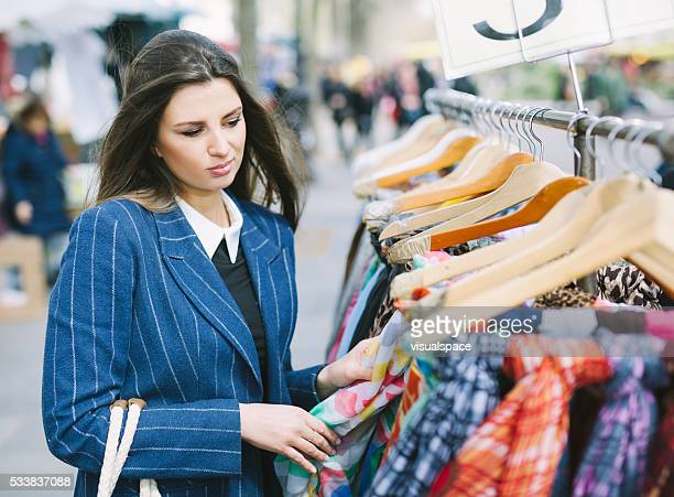 Young Woman Can't Decide What To Buy