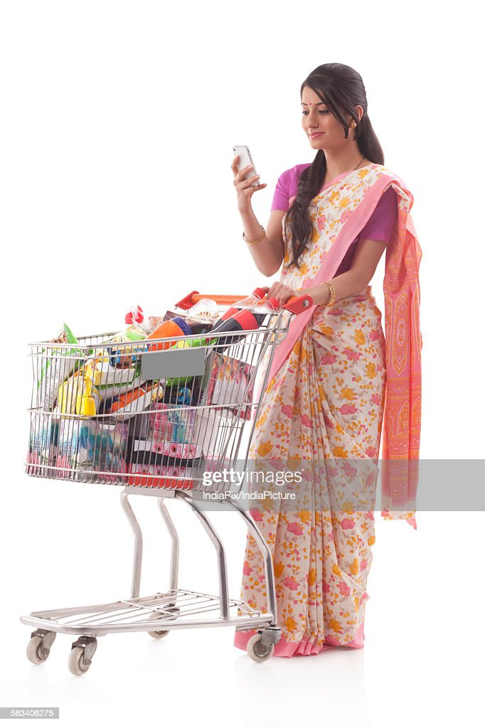 Young woman carrying a shopping cart : Stock Photo