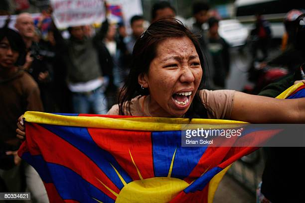 A young woman carrying a Tibetan flag screams after a clash with police during a Tibetan peace rally in front of the United Nations building on March...