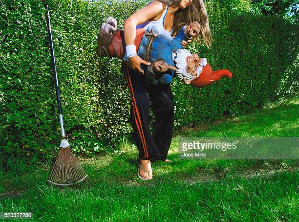 Young Woman Carrying Garden Gnome