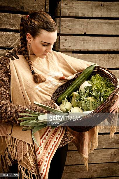 Young woman carrying home vegetables.