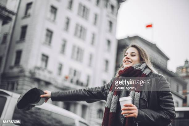 Young woman catching taxi