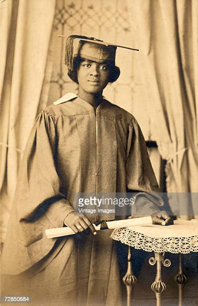 A young woman Catherine Isabel Brown poses in cap and gown with her diploma after graduating from Chester High School at CF Havercamp's photography...