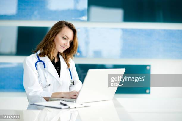 Young Woman Caucasian Doctor Nurse in Healthcare Clinic Office