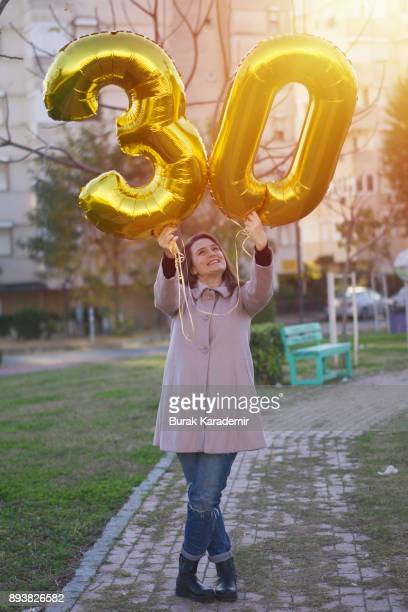 young woman celebrates a thirty years birthday - 30 34 years stock-fotos und bilder
