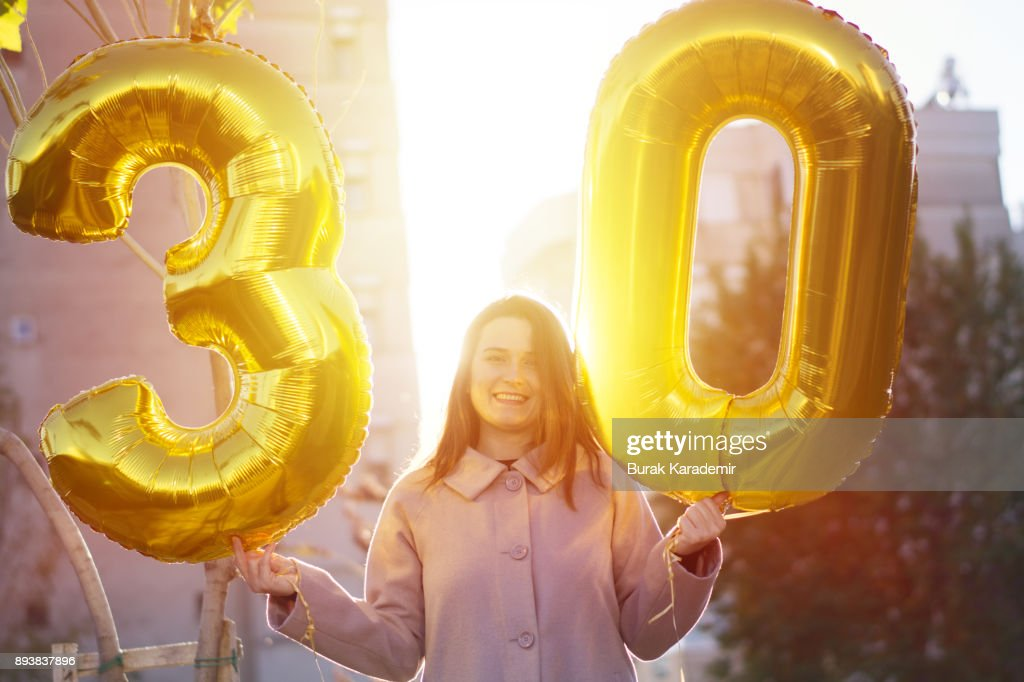 Young woman celebrates a thirty years birthday : Stock Photo