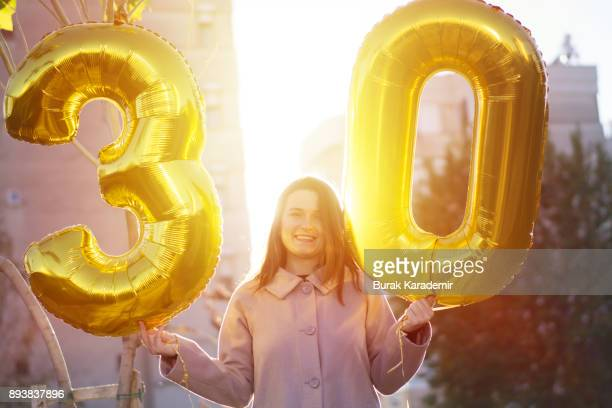 Young woman celebrates a thirty years birthday
