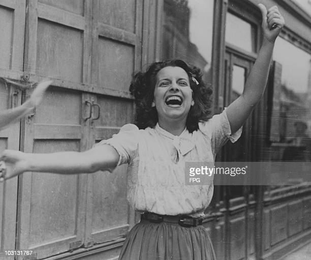 Young woman celebrates the Liberation of France, 1944.