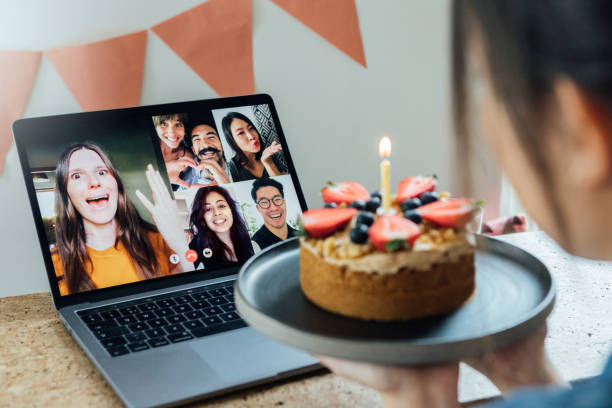 young woman celebrating birthday with friends on a video call using laptop - best friend birthday cake stock pictures, royalty-free photos & images