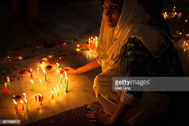 Young woman celebrating Diwali festival night also Bandi Chhor Divas celebration for the Sikh religion followers at the Gurdwara Dukh Nivaran Sahib...