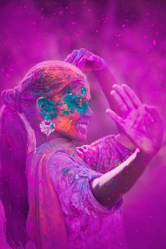 Young Woman Celebrating Holi Festival 583810616