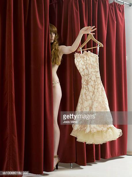 Young woman changing dress