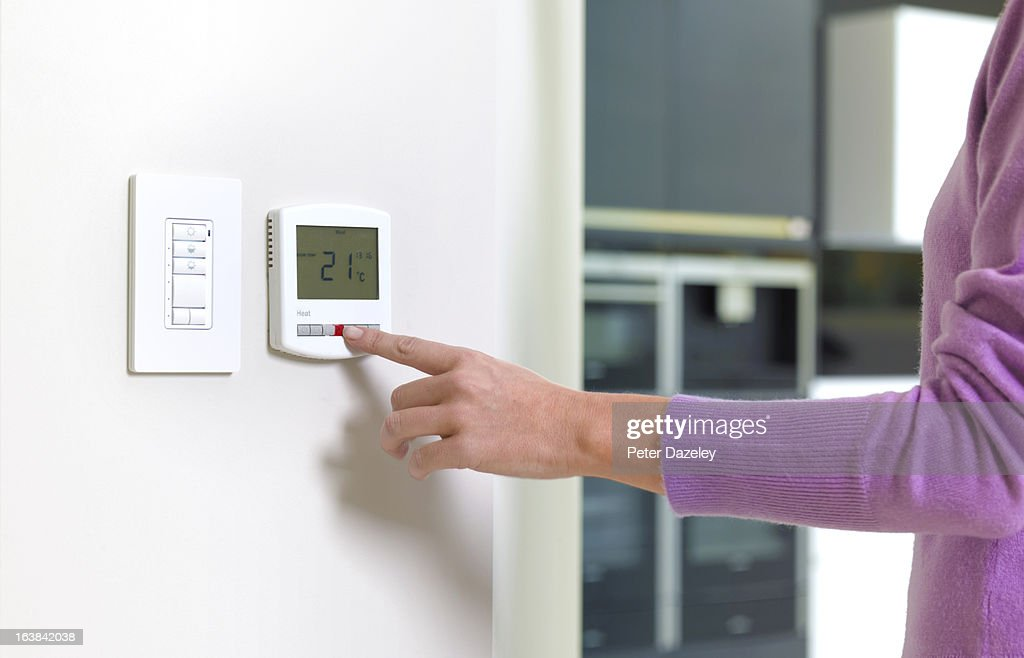 Young woman changing heating : Stock Photo