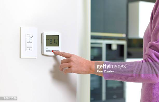 Young woman changing heating