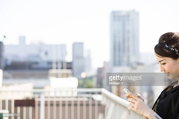 young woman checking a smartphone