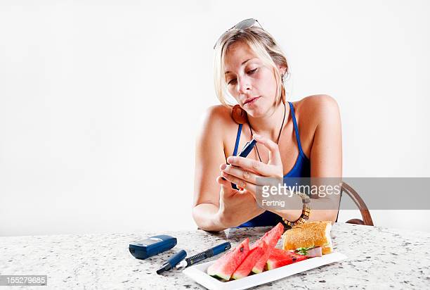 Young woman checking her blood sugar levels