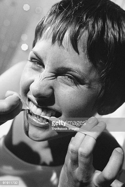 Young woman chewing on rubber band love